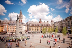 """The """"place"""" to be: people strolling across a sun-drenched Grand Place in Lille city centre"""