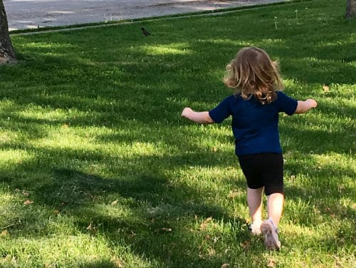 Toddler playing outside in the summer heat