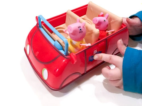 Toddler playing with a Peppa Pig Car Toy