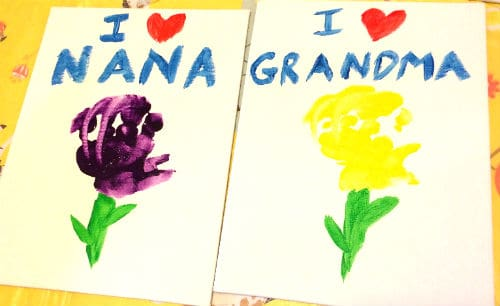 Canvas panels painted like flowers that say I love Nana and I love Grandma.