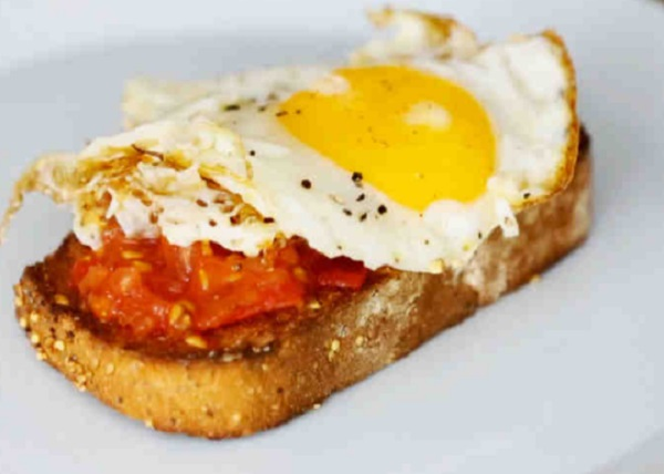 Tomatoes With Fried Eggs on Garlic Toast