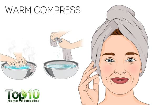 Use a warm compress to treat scalp sores