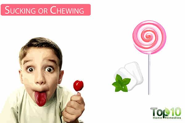sucking or chewing to reduce earache in kids