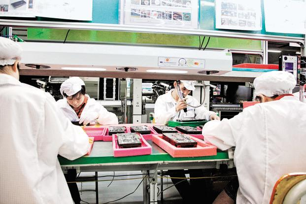 A file photo of workers at a Foxconn factory in Shenzhen, China. Rising labour costs in China and an eagerness to reduce dependence on that country are pushing manufacturers to new destinations such as India. Photo: Bloomberg