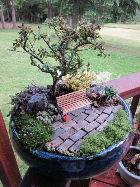 Magical Fairy Gardens Made From Broken Pots