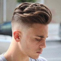 High Skin Fade With Long Thick Co