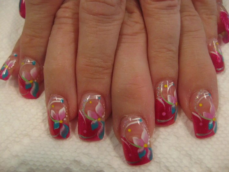 Deep pink tip, aquamarine flower shapes and swirls topped with pink petals, light green and sparkling swirls with white dots.