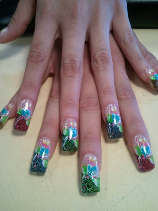Angled mesh (choice of color) on tip with white/sparkly swirl topped with green/blue/yellow petals and pink swirl.