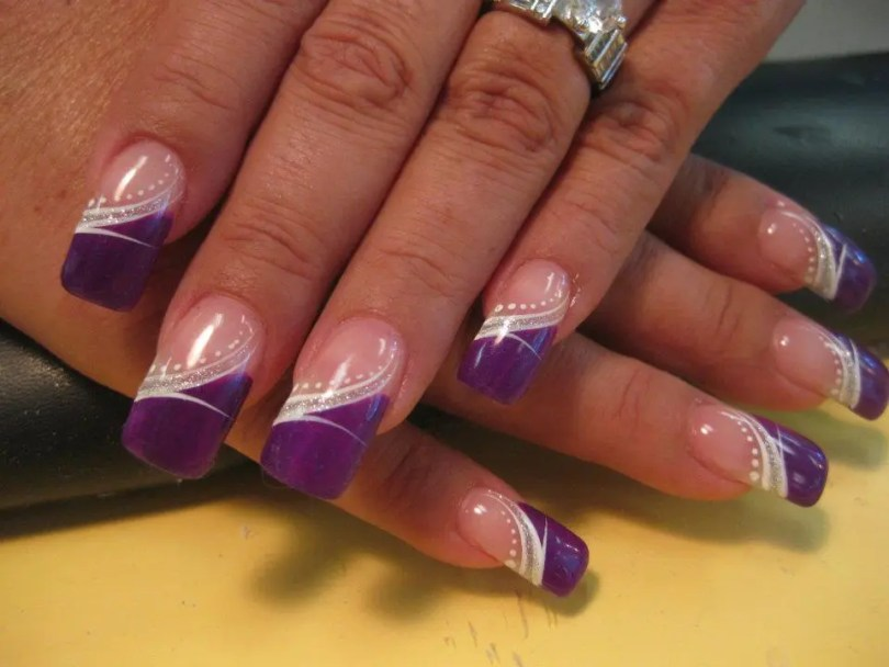 Angled Royal Purple tip with classy white swirl centered with swirled band of sparkles and white dots.