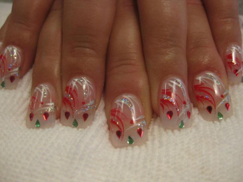Two ruby red/one holly green teardrop shapes on cloudy tip topped with red/white/sparkly swirls and red dot.