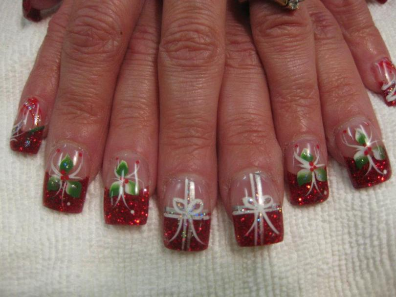 Sparkling Christmas red tip topped with either white/green mistletoe and red holly berries or white present bow or red/white/sparkly swirls.