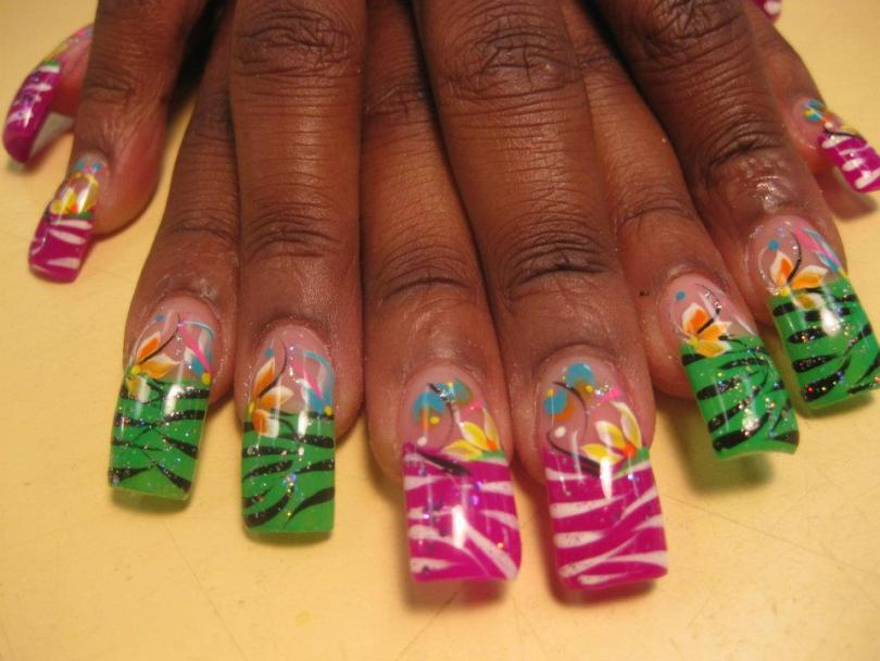 Green/Black or Bright Pink/White striped patterned tips topped with orange/white lily and blue/white petals, pink/black swirls, yellow/white/blue dots.