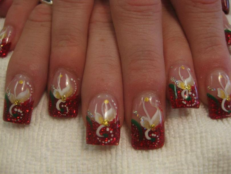 Sparkling Christmas red tip, flesh colored nail, holly green/red swirls, circle of white dots, white/gold flower with gold diamond glue-on.
