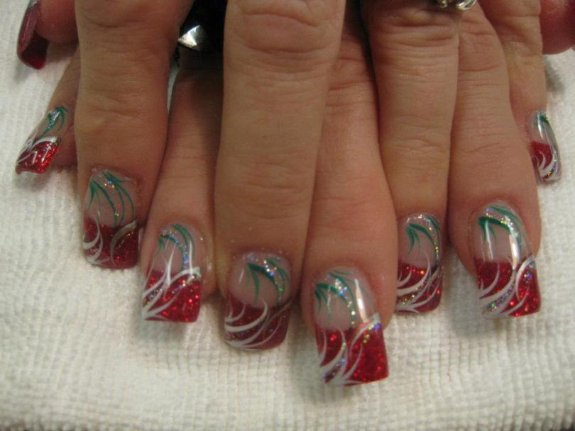Sparkling red tip with white blowing swirls topped with hanging green/sparkly swirls.