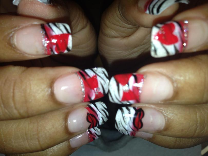 White black-striped zebra tip topped with red/sparkly bands and heart shapes.