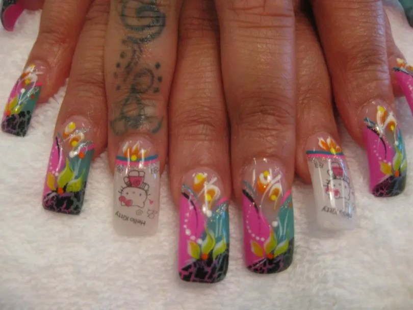 Hello Kitty emblem on cloudy white tip with pink/blue stripe and orange/white lily and yellow dot.