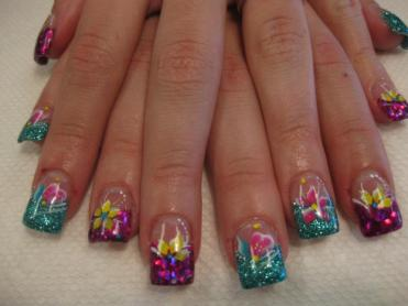 Purple/Pink/Blue kaleidoscope tip topped with yellow lily and white dot swirl.