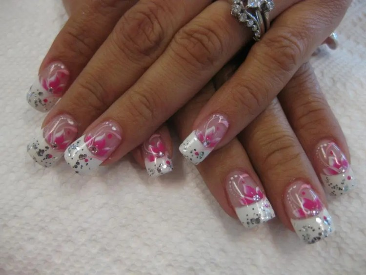 Brilliant white tip with mirrored glue-ons topped by bright pink/white lily with diamond glue-on center, pink swirls and white dots.