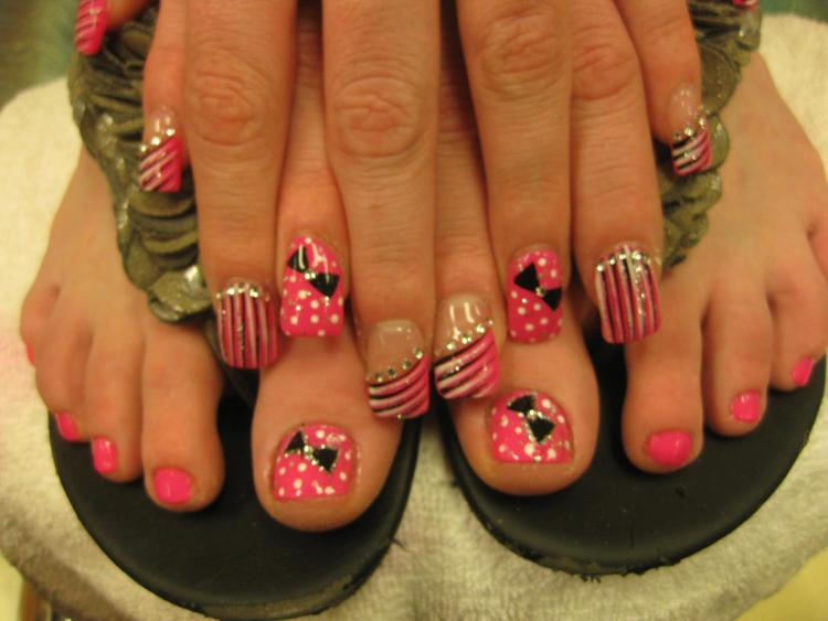 Bright pink full nail with white/sparkling dots and black bowtie with diamond glue-on center or black/white stripes w/multiple diamond glue-ons.