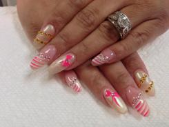 Full translucent white nail with choice of Fabergé style designs using pink/clear/yellow topaz glue-ons.