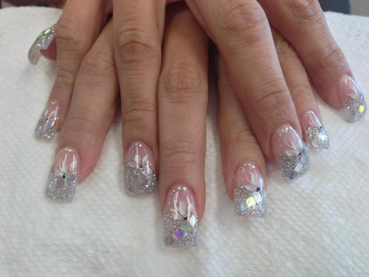 Sparkling cloudy tip with four diagonal mirrored panels, topped with white/crystal lily, and white dots.