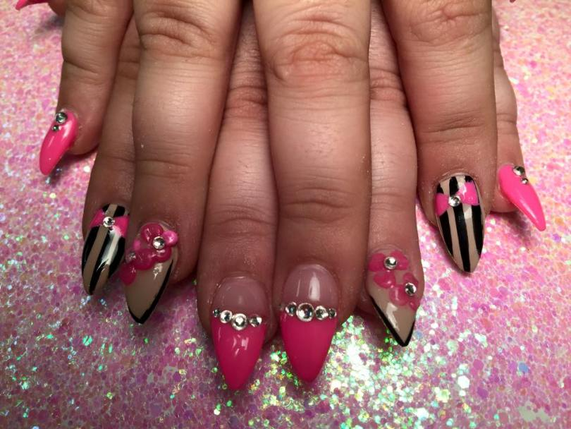 Pink, black lines with beautiful 3D flowers, cute 3d bow & diamonds nail art design.