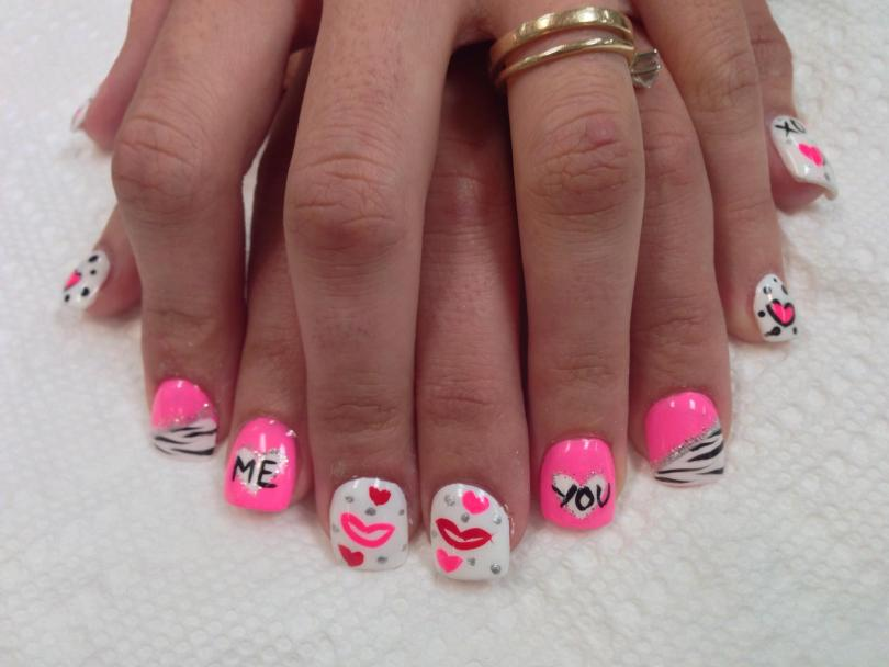 Various pink/red/white/sparkly designs with hearts, lips, and words for Valentine's Day.