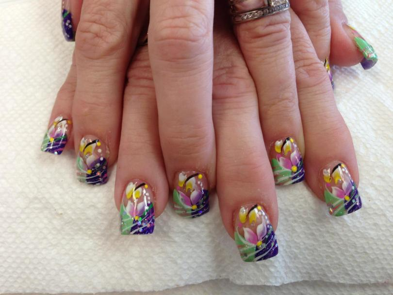 Half curved royal purple/half curved light green tip, pink/yellow/white lily petals, white/purple/green dots, white/black/green swirls.