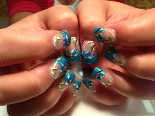 Sparkling aquamarine tip over clear nail, centered yellow topaz glue-on, blue/white and green/white calla lilies, gold/white/brown/black swirls, blue/white dots.