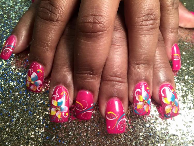 Bright pink nail, blue/white/yellow swirls, white dots/sparkles and optional yellow/pink/white/blue flower w/gold glue-on center.
