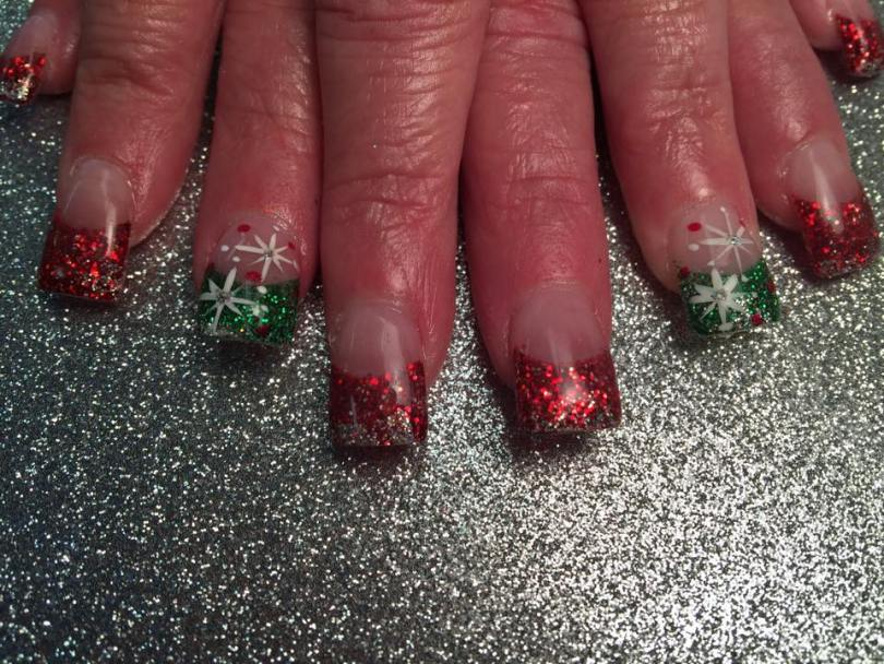 Glittery red or green tips with silver sparkles, and Bethlehem stars with centered diamond glue-on and white/red dots.