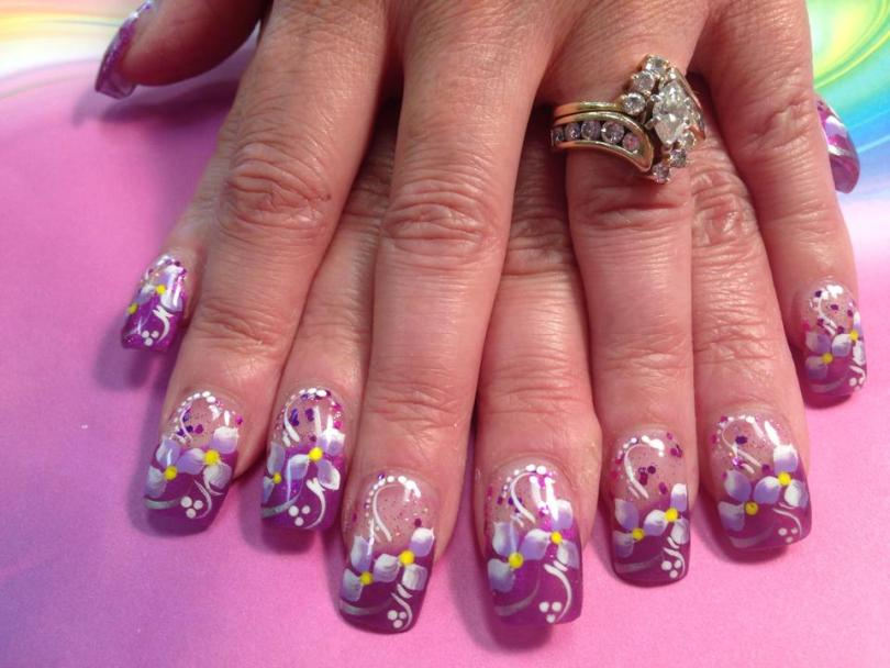 Sparkly lavender/pink tip with 2 lavender/white lilies, yellow dot centers, white/sparkly swirls, white/purple/pink dots.