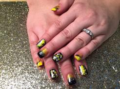 Full black nail w/yellow/white swishes/diamond glue-on OR Black tip under sparkly/yellow/gold, OR Angled yellow tip under black/sparkly wave, topped w/ sparkly/yellow/gold.
