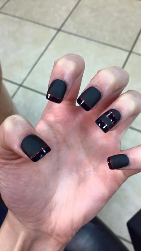 Shiny black tip, thin copper line, flat black nail.