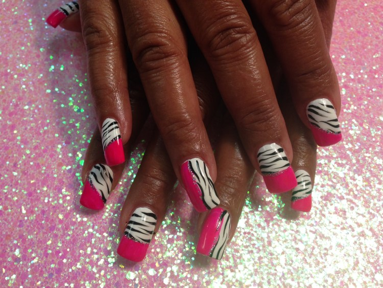 Shiny bright pink tip (straight or angled), under line of sparkles, topped w/black/white tiger stripes, OR Same but vertical on nail.