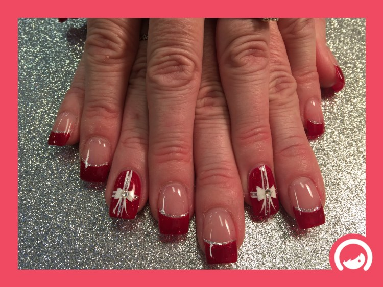 Sparkly Christmas red tip under thin silver sparkling crescent topped w/flesh colored nail OR Full sparkly Christmas Red nail w/white bow, diamond glue-on, double hashed white/sparkly ribbon.