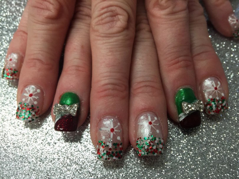 Choice: Shiny sparkly silver nail, green/red/white glue-ons under Bethlehem star OR angled sparkly red tip under white/sparkly band topped w/shiny Christmas green and sparkly/diamond bowtie.