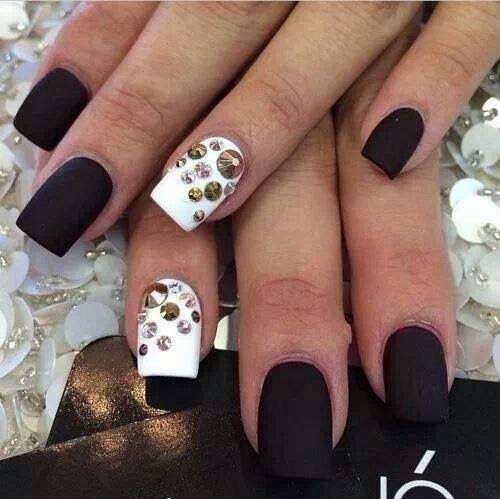 Flat black nails AND Opaque brilliant white nails w/several diamond/mirrored glue-ons.