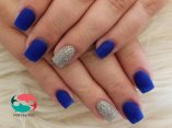 Matte blue with silver glitter accent nails
