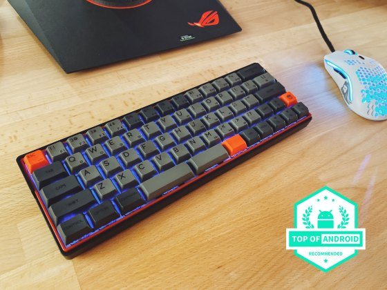 Kemove wireless mechanical keyboard on a desk next to a gaming model-o mouse in white