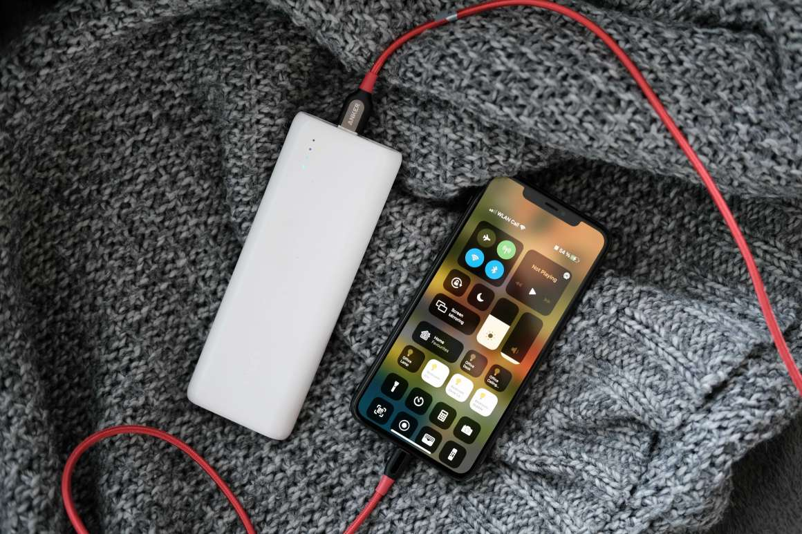 Anker PowerCore 20100 White charging iPhone 11 Pro Max with Red Anker Cable