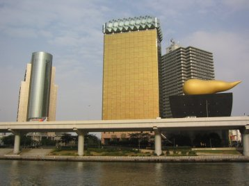 At the start of the cruise, you'll see the Asahi beer buildings, designed by Phillipe Starck. The one on the right is supposed to look like a head of foam on a beer, but has been nickname the golden turd.