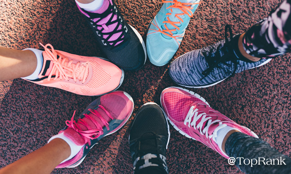 Runners touching colorful shoes together image.