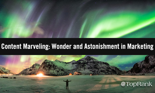 Northern lights over mountains with astounded person below.