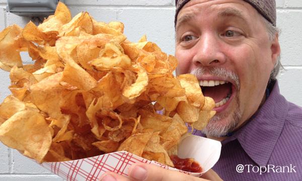 Lane R. Ellis eating spiral potatoes at the Minnesota State Fair in 2014.