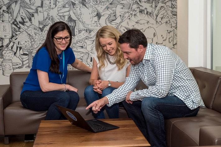 LinkedIn Marketing Solutions Team around Laptop
