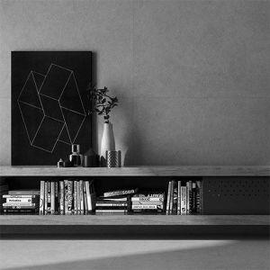 Antraciet grijze betonlook tegels aan de vloer en wand in een zwart wit interieur.
