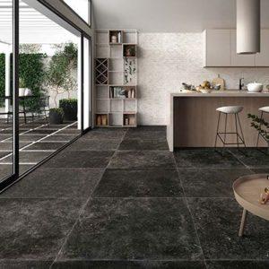 blauwsteen imitatie zowel als binnen in 1cm dik in de keuken als buitentegel in 2cm als tuin tegel.