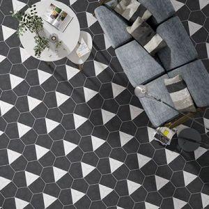 Hexagontegels met een zwart wit patroon.
