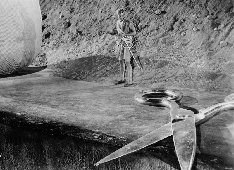 The Incredible Shrinking Man (Universal-International, 1957). Reduced to only a few inches in height due to exposure to a mysterious radioactive mist, John Scott Carey (Grant Williams) struggles to survive when he is trapped in his own basement after being attacked by the family cat. Click to enlarge.